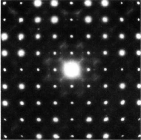 The electron diffraction patterns (along [001]) of two crystallites of Nb4W13O49